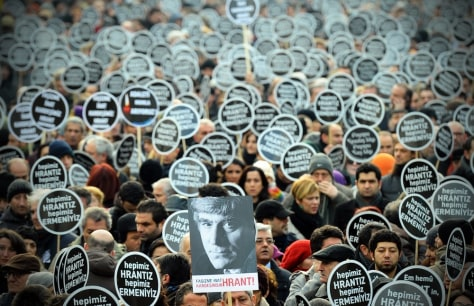 Image: Thousands march to mark journalist's death
