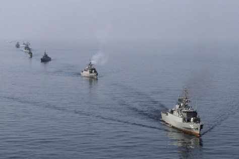 Image: Ships participate in naval parade on last day of Velayat-90 war game on Sea of Oman near Strait of Hormuz