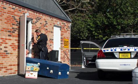 Image: Police investigate the discovery of a body in a rented storage unit on Thursday afternoon at U-Stor Self Storage