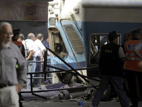 Image: Police and rescue workers surround a train that crashed at Once train station in Buenos Aires