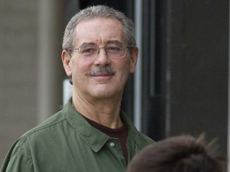 Image: Allen Stanford smiles as he waits to enter the Federal Courthouse where the jury is deliberating in his criminal trial in Houston
