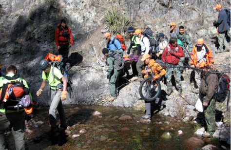 Image: Rescuers transport missing hiker Margaret Page