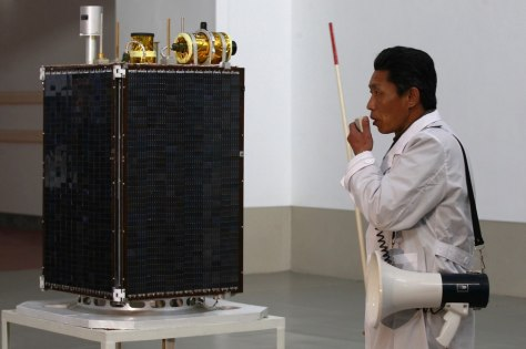 Image: Scientist introduces Kwangmyongsong-3 application satellite