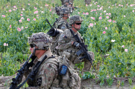 Image: US and Afghan soldiers patrol in Zharay district in Kandahar province, southern Afghanistan