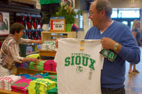 "Image: North Dakota voter holds up ""Fighting Sioux"" T-shirt"