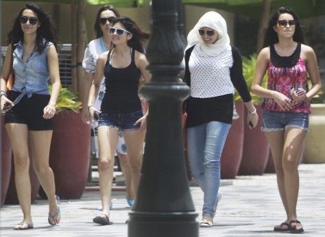Image: Women of different nationalities walk at the Jumeirah Beach Residence Walk in Dubai