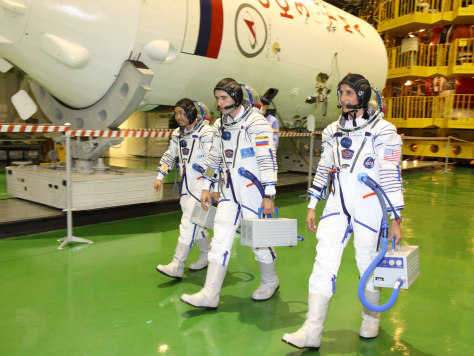 Image: Aki Hoshide, left, Yuri Malenchenko and Sunita Williams
