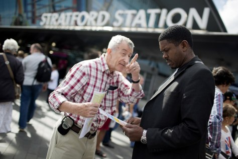 Image: George Chaplin, left, shares his Christian Science beliefs with passerby Barry McCalla outside Straford Bus Station.