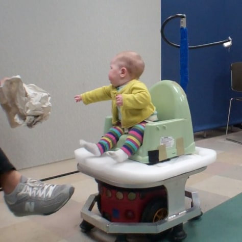 Image: Baby on a robot