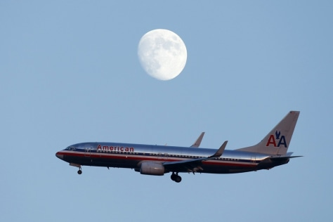 Image: An American Airlines passenger jet comes in the land at LaGuardia airport in New York