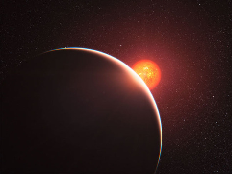 Image: Artist's impression of super-Earth exoplanet GJ 1214b passing in front of its faint red parent star.