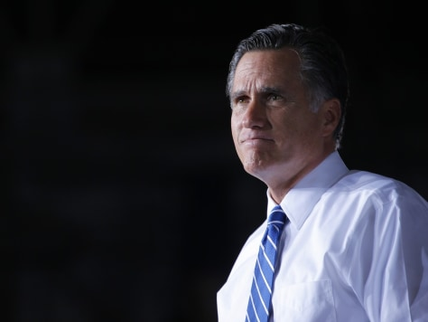 Image: Republican presidential candidate Romney pauses while speaking at a campaign rally in Denver