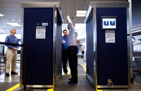 Image: TSA employees demonstrate a new full-body backscatter scanner
