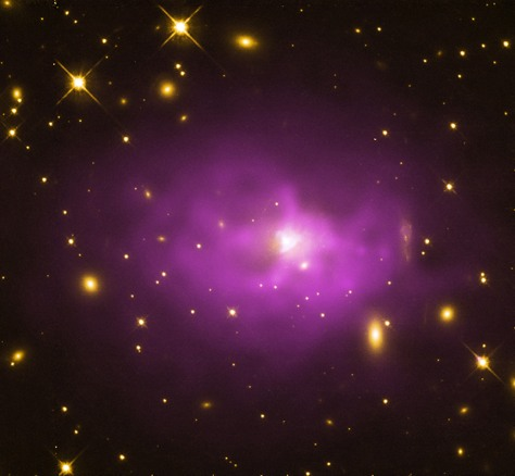 A galaxy cluster about 1.3 billion light years from Earth with a large elliptical galaxy in its center.