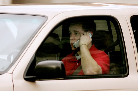 Image: Man talks on cell phone while driving