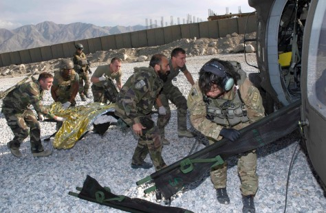 Image: Nato French soldiers evacuate wounded from Tagab, Afghanistan