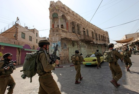 Image: Israeli soldiers patrol the old city in the West Bank city of Hebron