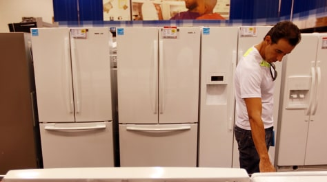 Image: Shopper checking out appliances