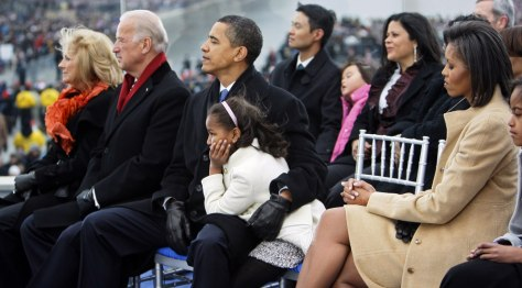 Image: Sasha Obama rests on her father's lap, at the Lincoln Memorial during an inaugural concert Sunday