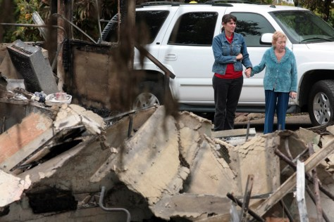 Image: Faye Pratini views destroyed home