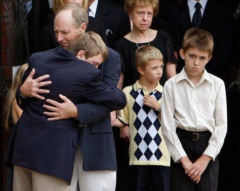 Image: Friends and family leave funeral