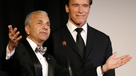 "Image: Dean of Education Bob Bassett, left, presents Governor Arnold Schwarzenegger with the inaugural ""Star award"" in 2007 at the premiere of the Dodge College of Film and Media Arts, held at Chapman University."