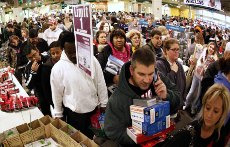Image: Shoppers wait in line