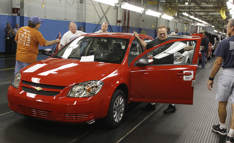 Image: Workers on General Motors assembly line