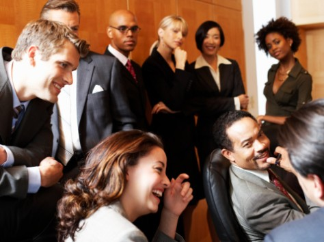 Image: Business men and women laughing