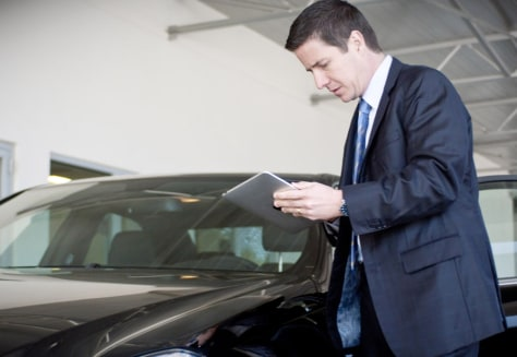 Bernie Moreno, the president of the North Olmsted, Ohio Mercedes-Benz, uses an iPad. Mercedes-Benz is just one of the businesses to adopt the iPad for everyday work.
