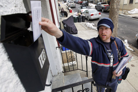 Image: Letter carrier Kevin Pownall delivers mail