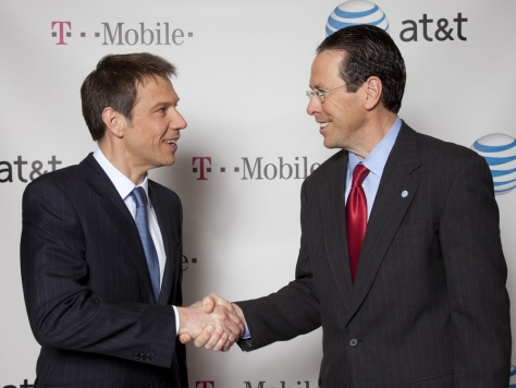 Image: Handout of AT&T Chairman and CEO Randall Stephenson and Deutsche Telekom Chairman and CEO Rene Obermann shake hands after announcing AT&T's $39 billion acquisition of T-Mobile USA in New York