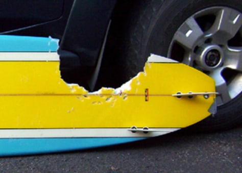 Image: Surboard with chunk taken out by shark