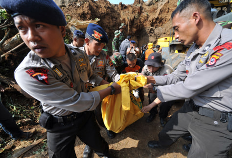 Image: Police move quake victim