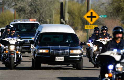 Image: A hearse carrying the casket of US District Court Judge John Roll