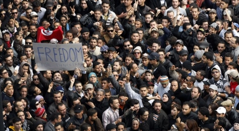 Image: Protesters chant slogans against President Zine El Abidine Ben Aliin during a demonstration in Tunis