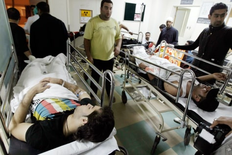 Image: Wounded Shiite Bahraini demonstrators at at a hospital Thursday