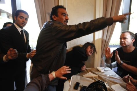 Image: Iman al-Obeidi is grabbed by a Libyan official at a hotel in Tripoli