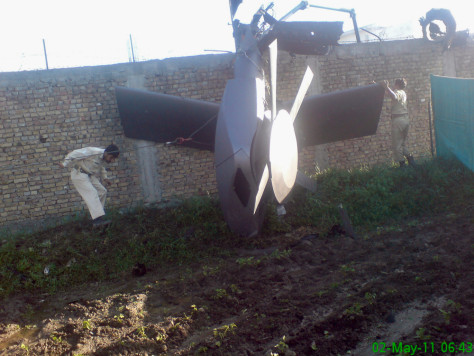Image: A damaged helicopter at the compound of Osama bin Laden in Abbottabad