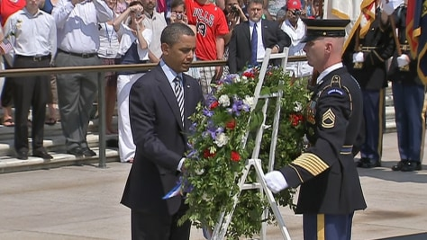 Image: President Barack Obama takes part in a wreath-laying ceremony at the Tomb of the Unknowns at Arlington National Cemetery