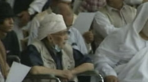 Image: Abdel Baset al-Megrahi sits in a wheelchair as he attends a pro-government rally in Tripoli