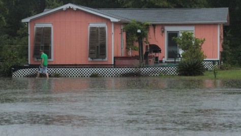 Image: Residents deal with flooding caused by record rainfall near the Gulf Coast of Florida