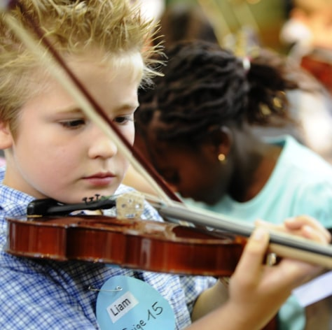 Image: A child plays an instrument