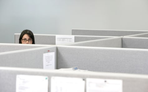 Image: Woman in cubicle