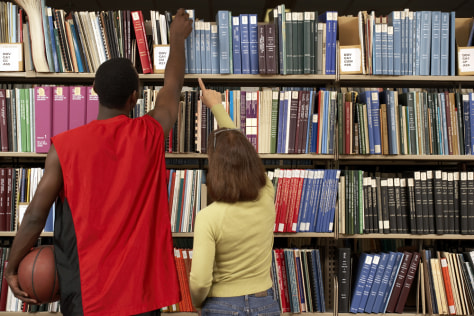 Image: Student athlete reaching for books in the library