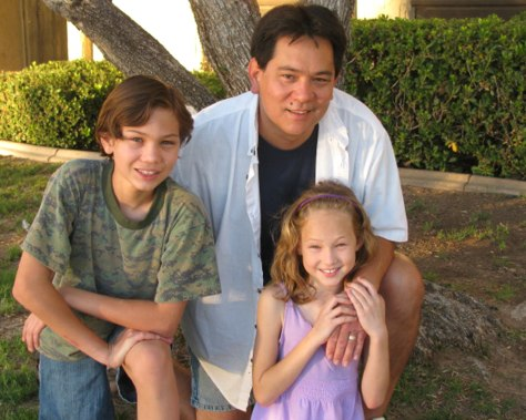 Image: Stuart Maeshiro, 45, his 12-year-old son, Garrett, and 9-year-old daughter, Tara