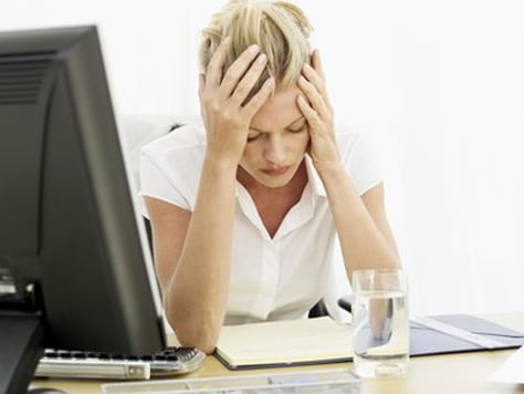 Image: Tired woman with computer