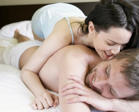 Image: Young couple on bed