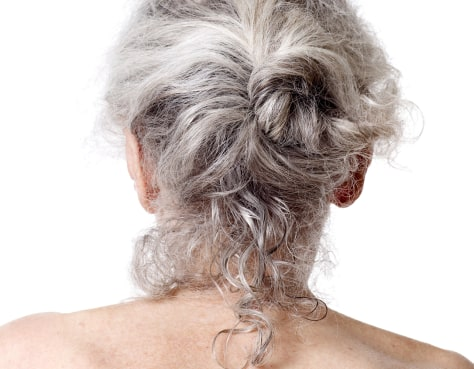 Image: Woman with gray hair.