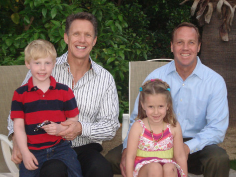 Image: Christopher Green, left, and Palm Springs Mayor Steve Pougnet, show with their twins Beckham and Julia
